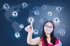Attractive female student connect to social network Stock Photo