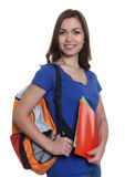 Attractive female student with long dark hair and backpack Stock Photography