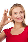 Attractive female student in red shows okay Royalty Free Stock Photos