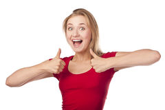 Attractive female student in a red, thumbs-up Stock Photos