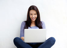 Attractive female student smiling with laptop Royalty Free Stock Photos