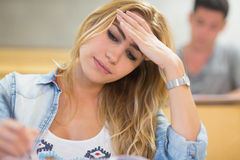 Attractive female student thinking during exam Royalty Free Stock Photo