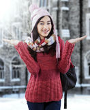 Attractive female student in warm clothes Stock Image