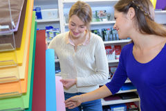 Attractive female students shopping in stationery Royalty Free Stock Photography