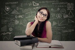 Attractive female study in class Stock Photography