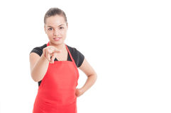 Attractive female supermarket seller supervising you Royalty Free Stock Photos