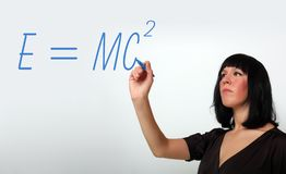 Attractive female teacher teaching algebra. Drawing on a glass sheet royalty free stock photography