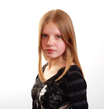 Attractive female teenager. Portrait of attractive female teenager with long auburn hair; white studio background Stock Photography