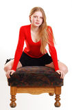 Attractive female teenager. Sat on chair with white studio background Royalty Free Stock Image