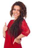Attractive female with thumbs-up and OK gesture Royalty Free Stock Photos