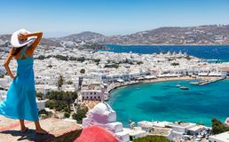 Attractive female tourist enjoys the view over the town of Mykonos stock photo