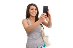 Attractive female tourist taking selfie. Isolated Royalty Free Stock Photography
