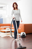 Attractive Female with Vacuum Cleaner royalty free stock photography