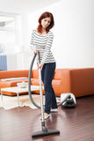 Attractive Female with Vacuum Cleaner Stock Photos