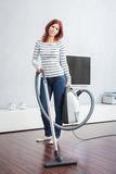 Attractive Female with Vacuum Cleaner Stock Images