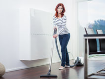Attractive Female with Vacuum Cleaner Royalty Free Stock Photos