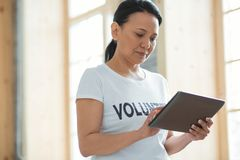 Attractive female volunteer typing message Royalty Free Stock Images