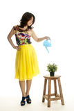 Attractive female with a watering can Stock Photography