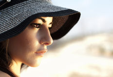 Attractive female wearing hat. Image of attractive arabic female wearing black beach hat, closeup portrait of stylish elegant woman, beautiful girl isolated on Royalty Free Stock Photography