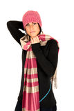 Attractive female wearing pink hat and holding sca Royalty Free Stock Photography