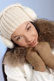 Attractive female in white cap and earmuffs Stock Photo