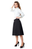 Attractive female in white shirt and black skirt Stock Photo