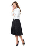 Attractive female in white shirt and black skirt Stock Image
