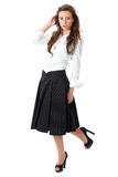 Attractive female in white shirt and black skirt Royalty Free Stock Photography