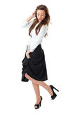 Attractive female in white shirt and black skirt Stock Photos