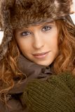 Attractive female in winter clothes Royalty Free Stock Photos