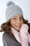 Attractive female in winter clothes smiling Royalty Free Stock Image