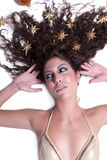 Attractive female woman's face with gold stars on her hair Stock Photography
