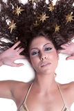 Attractive female woman's face with gold stars on her hair Royalty Free Stock Images
