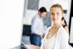 Attractive female worker in office Stock Photo