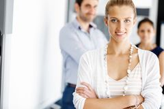 Attractive female worker in office Royalty Free Stock Photography