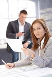 Attractive female working at desk in office Royalty Free Stock Photography