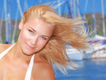 Attractive female in yacht port Royalty Free Stock Images