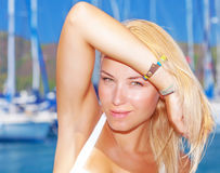 Attractive female in yacht port Royalty Free Stock Image