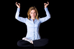 Attractive female in yoga pose, isolated on black Royalty Free Stock Images