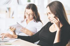 Attractive females talking on phone Stock Photos