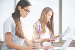 Attractive females working on project Stock Images