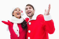 Attractive festive couple posing with hands up Royalty Free Stock Photos
