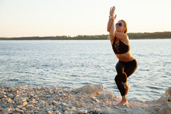 Attractive fit healthy woman yoga asana on sunset Stock Image