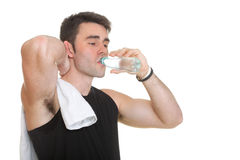 Attractive fit man drinking water after training Stock Photos