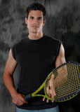 Attractive, Fit Man With Tennis Racket Stock Image