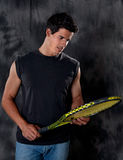 Attractive, Fit Man With Tennis Racket Stock Photography