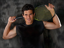 Attractive, Fit Man With Tennis Racket Royalty Free Stock Images