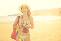 Attractive fit trendy modern hipster woman taking photos with retro vintage film camera.Lifestyle photographer Royalty Free Stock Image