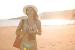 Attractive fit trendy modern hipster woman taking photos with retro vintage film camera.Lifestyle photographer royalty free stock photo