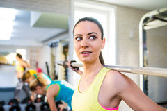 Attractive fit woman in gym exercising with weights Royalty Free Stock Photo